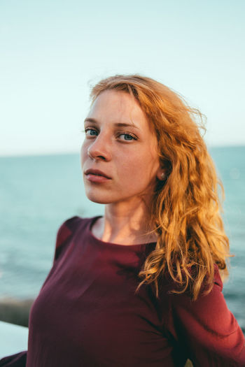 Portrait of woman against sea and sky