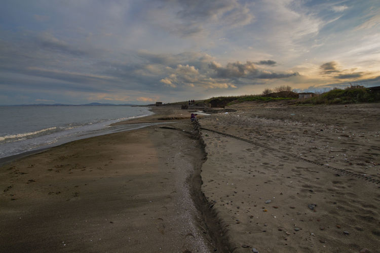 Water Beach Sky Land Sea Cloud - Sky Sand Scenics - Nature Nature Tranquility Tranquil Scene Beauty In Nature Sunset Incidental People Wet Horizon Horizon Over Water Outdoors Coastline
