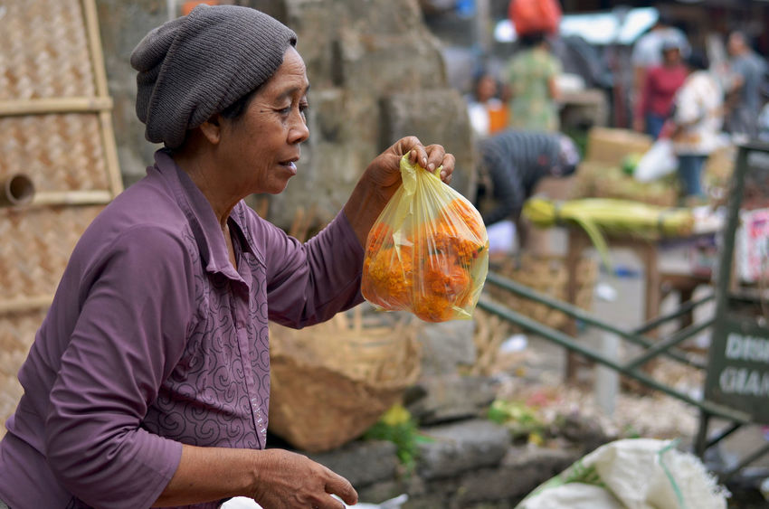 Balinese Balinese Life Balinese Woman Day Focus On Foreground Leisure Activity Lifestyles Market Market Stall Outdoors Portrait Selective Focus Woman