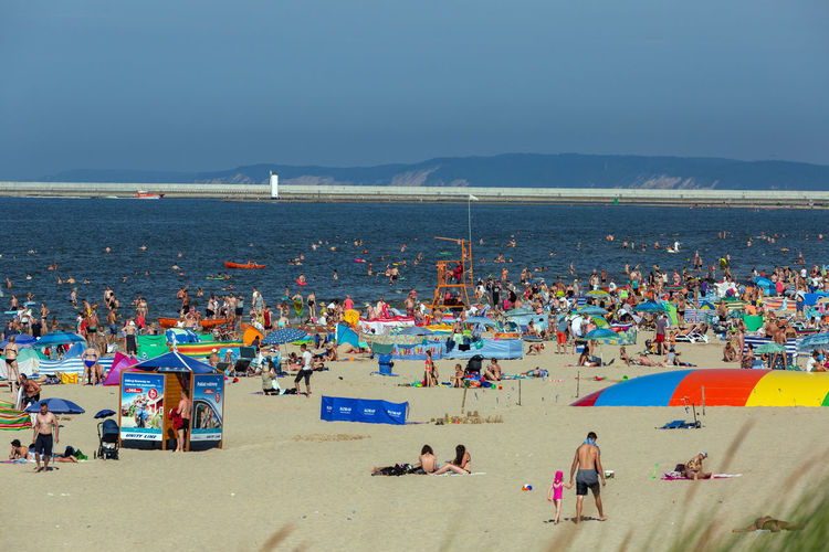 Baltic Sea Beach Crowd Enjoyment Group Of People High Angle View Holiday Horizon Over Water Land Large Group Of People Leisure Activity Lifestyles Nature Outdoors Real People Sand Sea Sky Trip Vacations Water