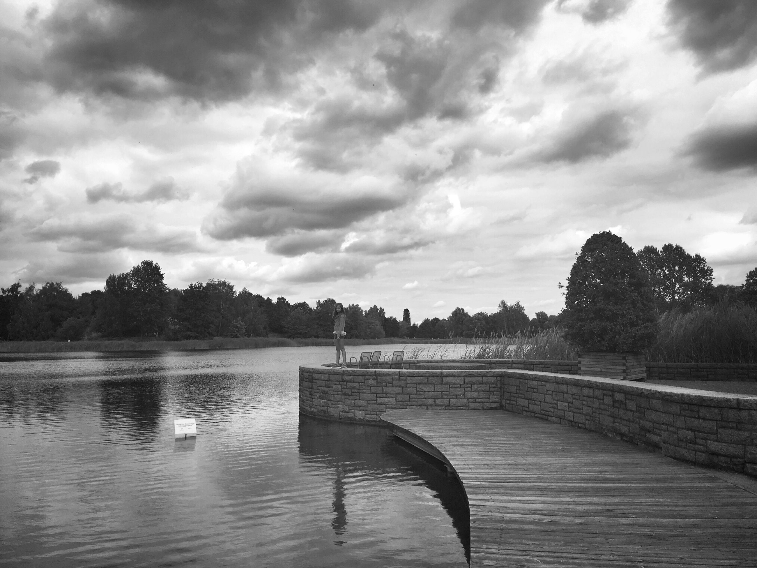 sky, water, cloud - sky, lake, tree, tranquility, tranquil scene, cloudy, river, cloud, scenics, nature, beauty in nature, overcast, rippled, day, outdoors, lakeshore, idyllic, no people, non-urban scene, calm, landscape, weather, growth, remote, non urban scene