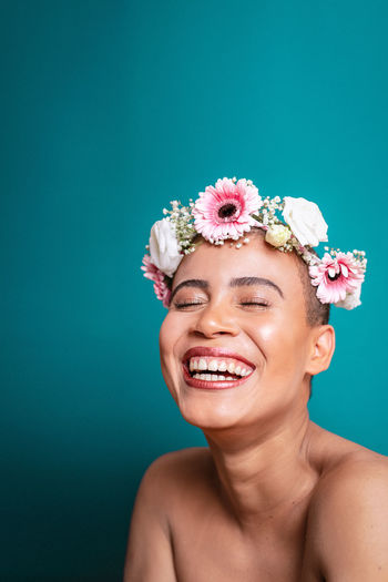 Colored Background Portrait Studio Shot One Person Headshot Smiling Happiness Young Adult Blue Indoors  Blue Background Beauty Copy Space Women Beautiful Woman Emotion Looking At Camera Young Women Wearing Flowers Green Background Turquoise Colored Flower Head