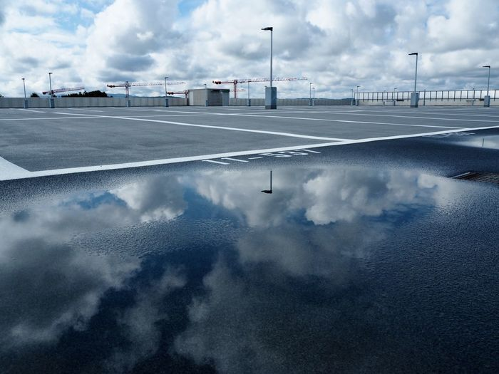 View of empty road against cloudy sky