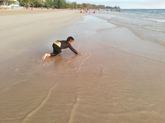 Children enjoy on summer trip 2019,หาดเจ้าหลาว Achi2019 Land Sand Beach Real People Lifestyles One Person Leisure Activity Full Length Incidental People Men Sport Nature Water Sea Day Enjoyment High Angle View Casual Clothing Outdoors Boy