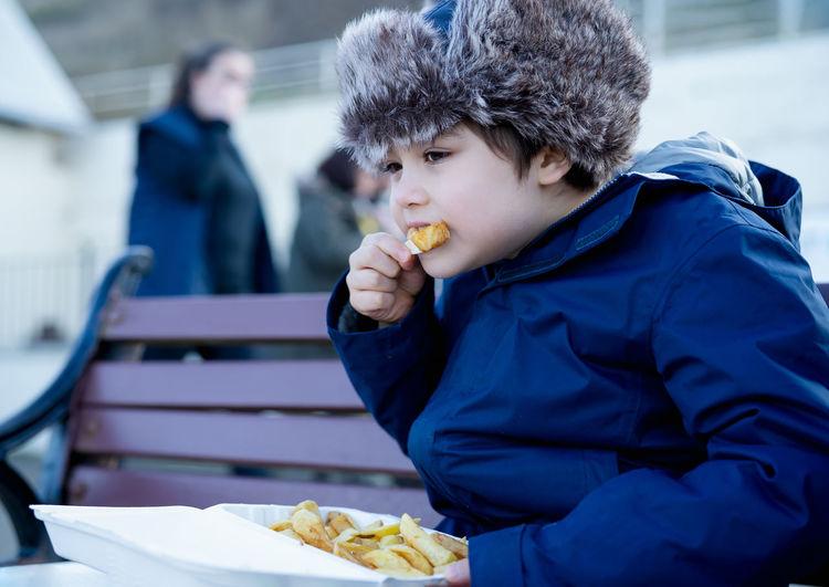 Full length of man eating food