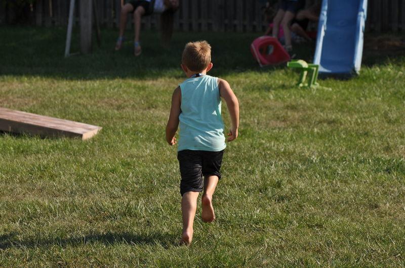 Young Boy Running Away Through a Park Fun Running Young Boy Outdoors Park Playing Spring Summer