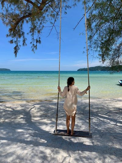 Nature Sea Water Beauty In Nature Cambodia Koh Rong Samloem Island Life Island Scenics - Nature Non-urban Scene Full Length Beach Land Real People Rear View Leisure Activity One Person Young Women Swinging Swings Tropical Paradise Tropical Climate Vacation Time Happiness Beach Photography