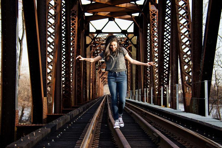 Full length of woman walking on railroad track