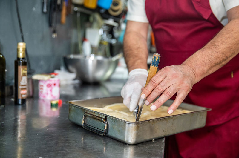 Close-up of man working in kitchen