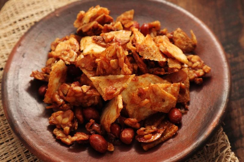 Sweet and Crunchy. Potato chips, roasted peanuts and tempeh coated with brown sugar. Snack Time! Peanuts Caramel Sugar Coated Potato Chips Food Food And Drink Freshness Healthy Eating Close-up Ready-to-eat No People Meal Fried Asian Food Indoors  Table