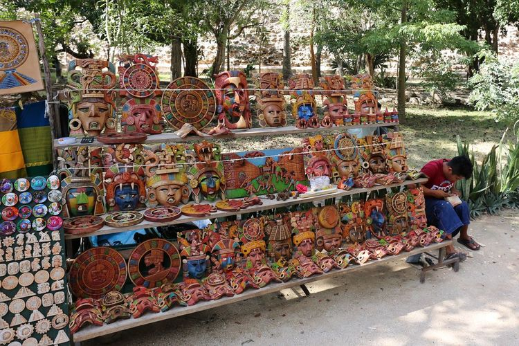 Souvenirs Chichen Itza Souvenir Shop Choice Day For Sale Full Length Large Group Of Objects Multi Colored One Person Outdoors People Real People Souvenir Seller Souvenir Stand Souvenirs Tree
