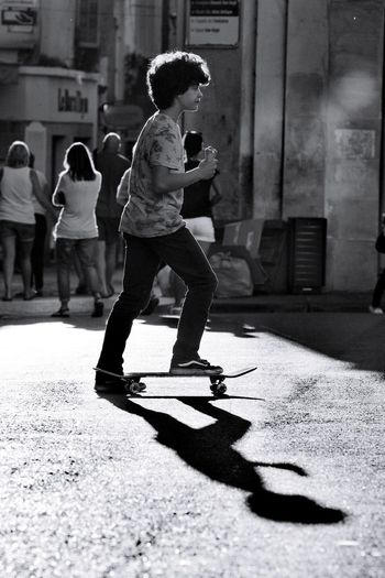 skating kids Blackandwhite Nikon Nikonphotography Streetphotography Street City Full Length Sport Shadow Childhood Motion Sunlight Ice Rink Building Exterior Children City Street Skateboard Skate Photography: Same Tricks, New Perspectives The Art Of Street Photography