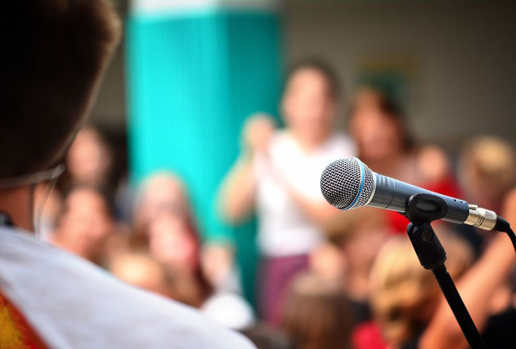 Adult Audience Auditorium Business Business Conference Communication Conference - Event Crowd Event Group Of People Incidental People Input Device Meeting Men Microphone Presentation Press Conference Public Speaker Sound Recording Equipment Spectator Speech Stage Talking Technology The Media