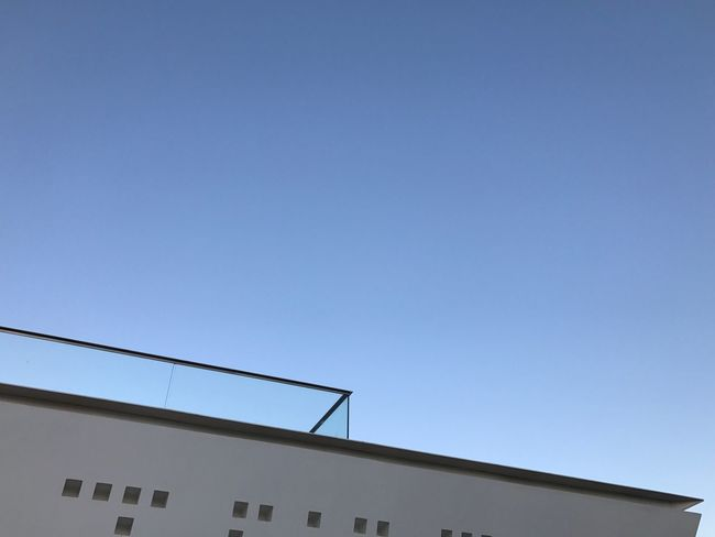 Let's Go. Together. Built Structure Architecture Building Exterior Copy Space Clear Sky Low Angle View Blue House No People Roof Outdoors Day Residential Building Technology Television Aerial Sky