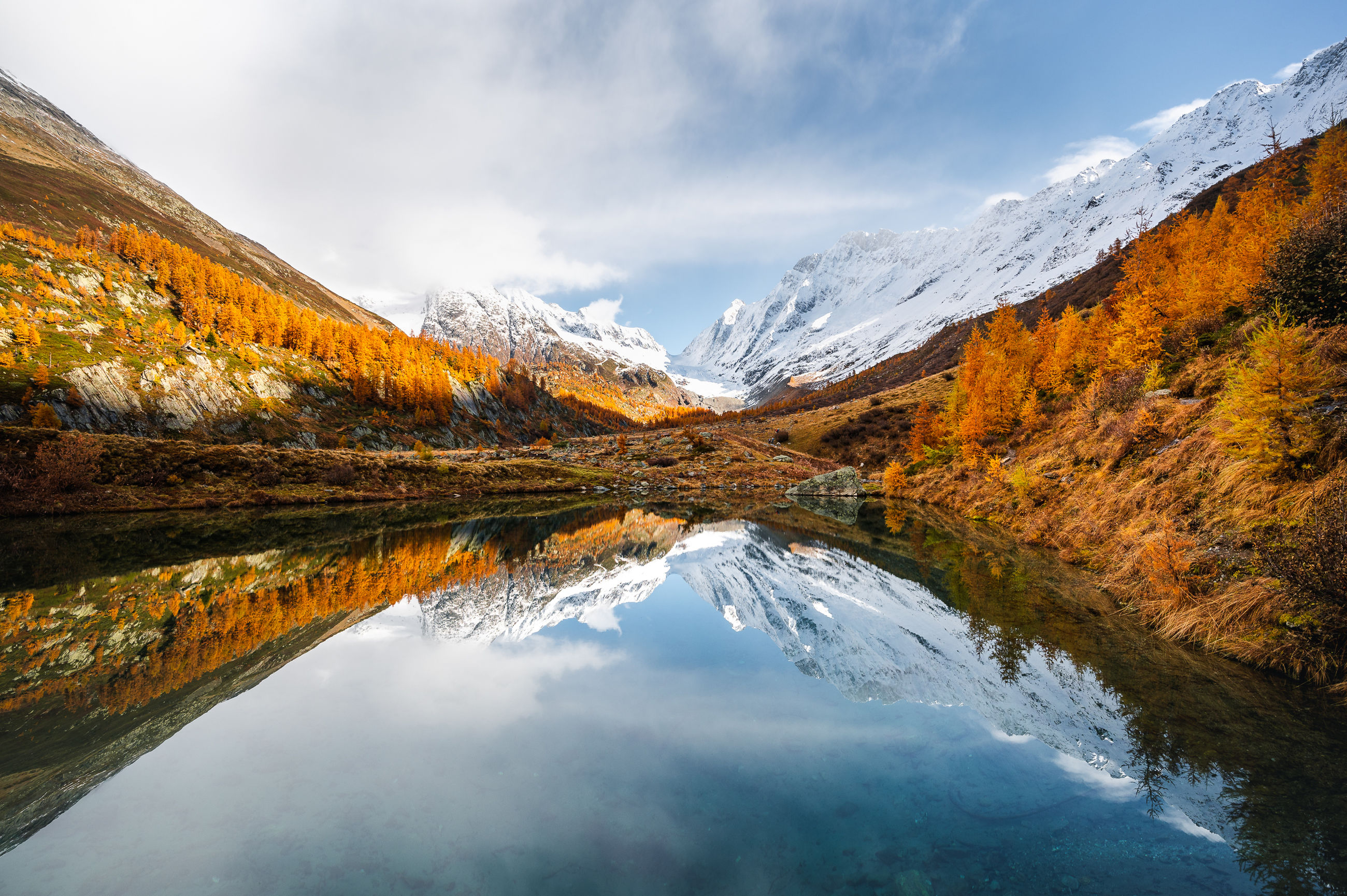 nature, water, mountain, scenics - nature, reflection, beauty in nature, environment, landscape, sky, lake, cloud, autumn, mountain range, wilderness, land, tree, forest, cold temperature, snow, tranquility, winter, tranquil scene, no people, plant, travel destinations, travel, snowcapped mountain, fog, outdoors, coniferous tree, non-urban scene, mountain peak, morning, multi colored, pinaceae, idyllic, pine woodland, pine tree, activity, tourism, leaf, vibrant color, ice, blue, day, woodland, rock, sun, valley, vacation, trip