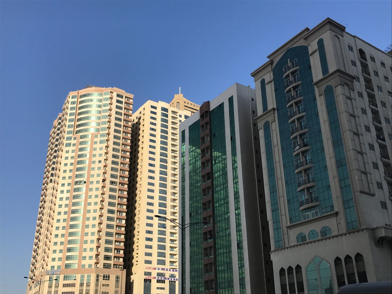 architecture, building exterior, built structure, low angle view, city, skyscraper, day, no people, blue, clear sky, modern, outdoors, cityscape, sky
