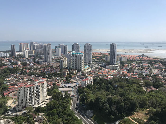 Cityscapes besides the coastline. Architecture High Angle View Building Exterior Cityscape Clear Sky Skyscraper City Sea Day Outdoors No People Built Structure Modern Tree Water Urban Skyline Downtown District Growth Sky Nature