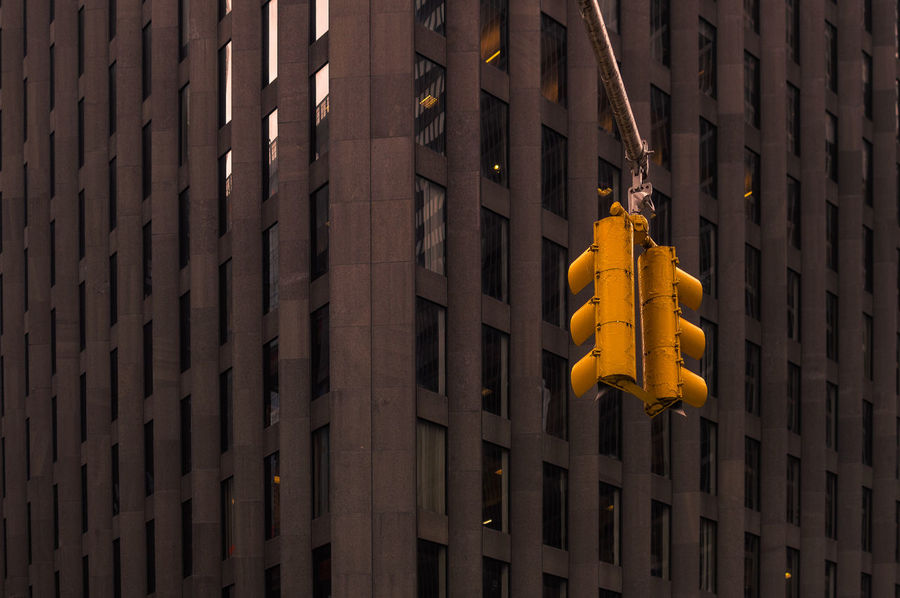 Traffic Lights in the Concrete Jungle Business Focus Object I Love New York Looking Up! Manhattan New York City Architecture Brown Color Building Exterior Built Structure Business Finance And Industry Close-up Commericial Contrasting Colors Day Glass Metal No People Outdoors Pattern Street Photography Traffic Lights Windows Yellow Yellow Color Summer Road Tripping The Street Photographer - 2018 EyeEm Awards The Traveler - 2018 EyeEm Awards The Photojournalist - 2018 EyeEm Awards The Great Outdoors - 2018 EyeEm Awards My Best Travel Photo
