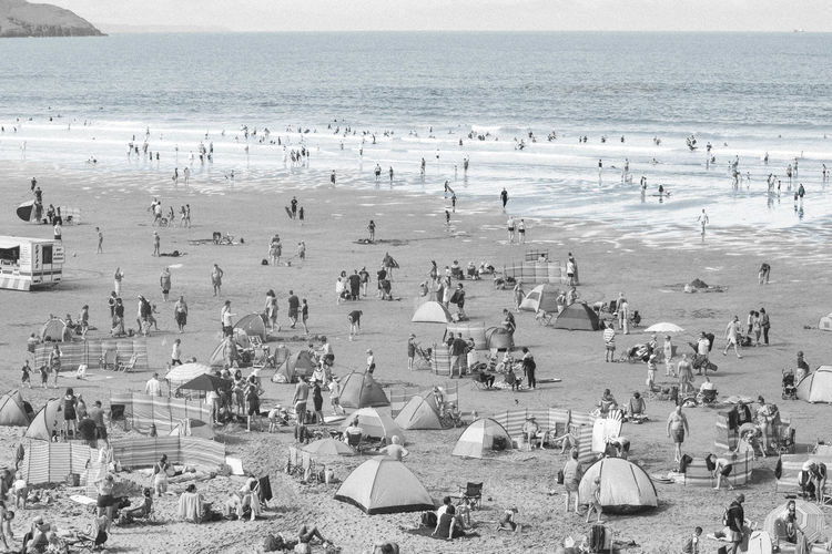 Beach Beauty In Nature Black & White Black And White Calm Crowd Day Horizon Over Water Large Group Of People Mixed Age Range Nature Ocean Scenics Sea Shore Summer Tourist Tranquil Scene Tranquility Vacations Water Weekend Activities Monochrome Photography British Holiday Holiday