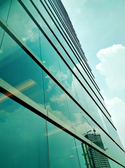 There it goes, up in the sky Sky Glass Reflection Glass Reflection Window Reflections Window View Clear Sky Pattern Design Pattern ELJCC Bldg Quezon City Enjoying The View
