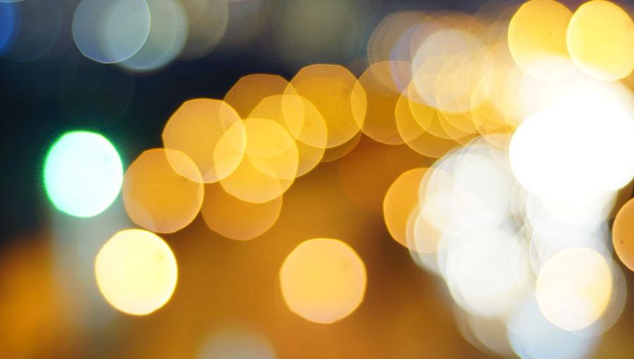 Blurry photo light and bokeh.illuminated at night. Abstract Abstract Backgrounds Backgrounds Christmas Lights Circle Decoration Defocused Electric Light Electricity  Full Frame Geometric Shape Glowing Illuminated Lens Flare Light Light - Natural Phenomenon Lighting Equipment Night No People Outdoors Pattern Shape Yellow