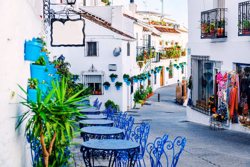 Mijas street. Charming white village in Andalusia, Costa del Sol. Southern Spain Andalucía Architecture Blue Color Building Exterior Colorful Costa Del Sol Decorated Empty Street Europe Flowers Pots Mijas Narrow Street No People Nobody Open Air Cafe Outdoors Restaurant Picturesque Potted Plant Scenery Sidewalk SPAIN Tables And Chairs Village White Village Whitewashed Houses