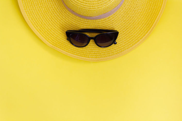 Close-up of sunglasses on hat