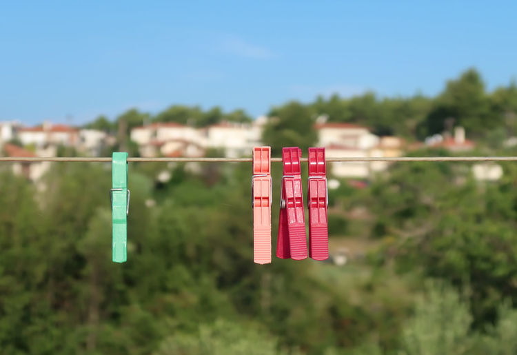Clothespins on a rope Bundle Household Housework Rope Sunny Attached Close Up Close-up Clothes Pin Clothes-peg Clothesline Clothespeg Clothespin Colorful Day Green Color Hanging In A Row Nature No People Outdoors Protection Red Sky Sunlight
