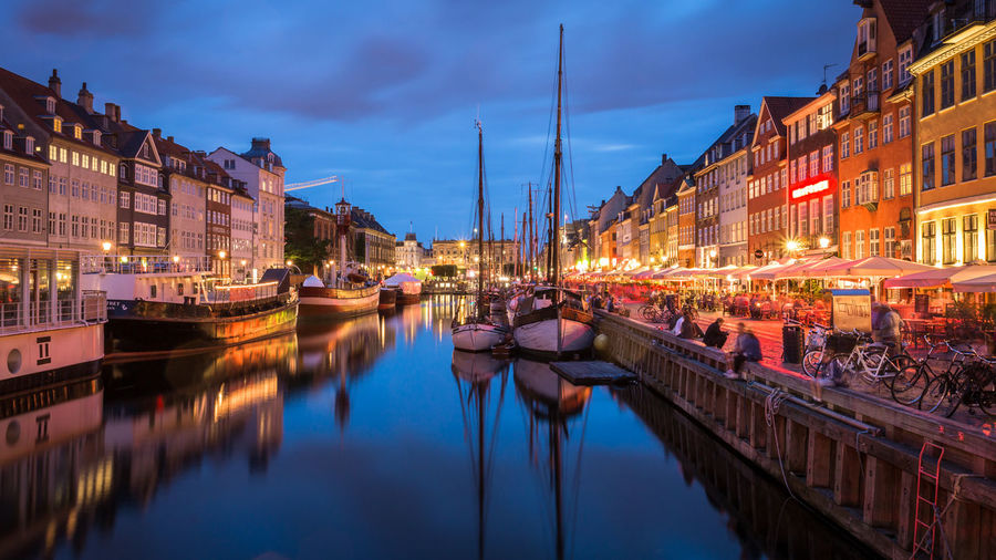Nyhavn at dusk Architecture Blue Hour Boat Building Exterior Built Structure Canal City Copenhagen Denmark Dusk Harbour Long Exposure Mode Of Transport Moored Nautical Vessel Nyhavn Outdoors Reflection Residential Structure Scandinavia Summer In Denmark Transportation Twilight Seeing The Sights Market Bestsellers September 2016 Bestsellers