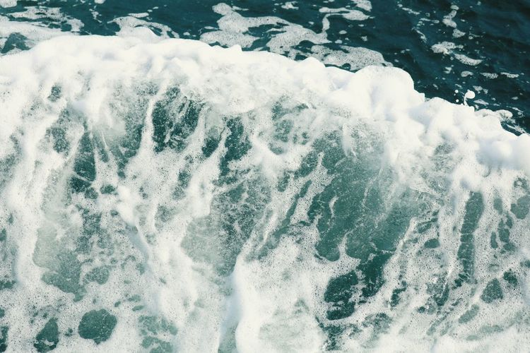 High angle view of waves splashing in sea