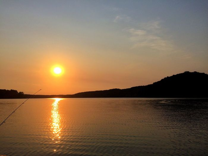 Sunset over lake Monroe Lake Sunset Sky Water Scenics - Nature Beauty In Nature Sea Tranquility Outdoors Non-urban Scene No People Reflection Silhouette Nature Land Idyllic Sun Tranquil Scene Sunlight Orange Color Beach