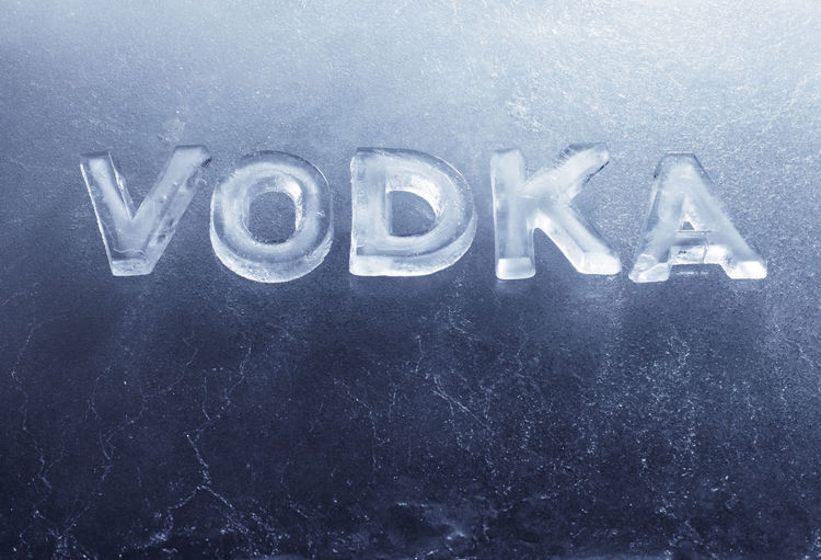 Word Vodka written with real ice letters. Chilled Cool Frozen Text Winter Word Alcohol Cold Drink Freeze Indoors  Text Vodka