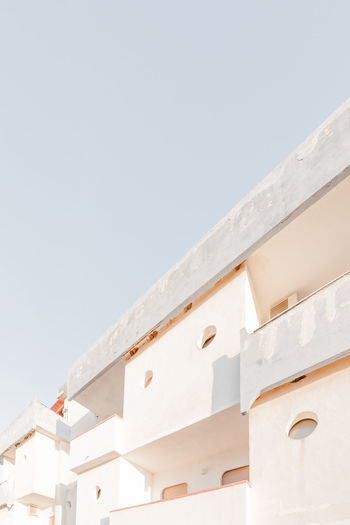 old beachhotel Architecture Beach Architecture Blue Building Building Exterior Built Structure City Clear Sky Concrete Copy Space Day High Key High Section House Low Angle View No People Outdoors Residential Building Residential Structure Roof Sky White Color Window The Mix Up