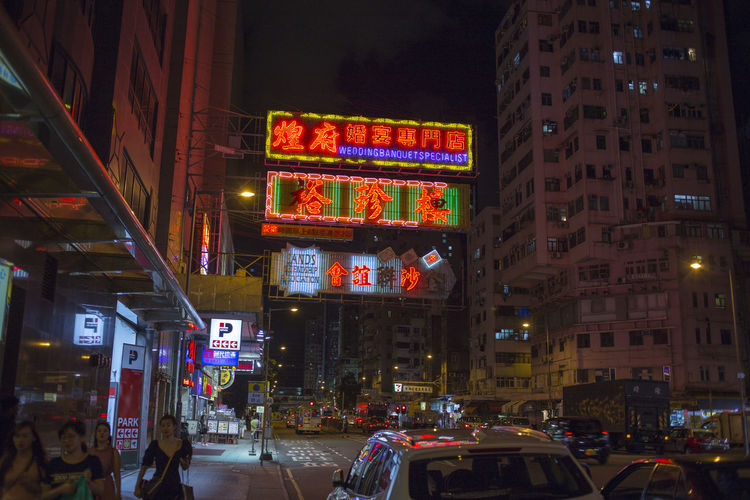 Hong Kong HongKong Architecture Building Building Exterior Built Structure Car City City Life City Street Communication Illuminated Incidental People Land Vehicle Mode Of Transportation Motion Motor Vehicle Neon Night Outdoors Street Text Transportation