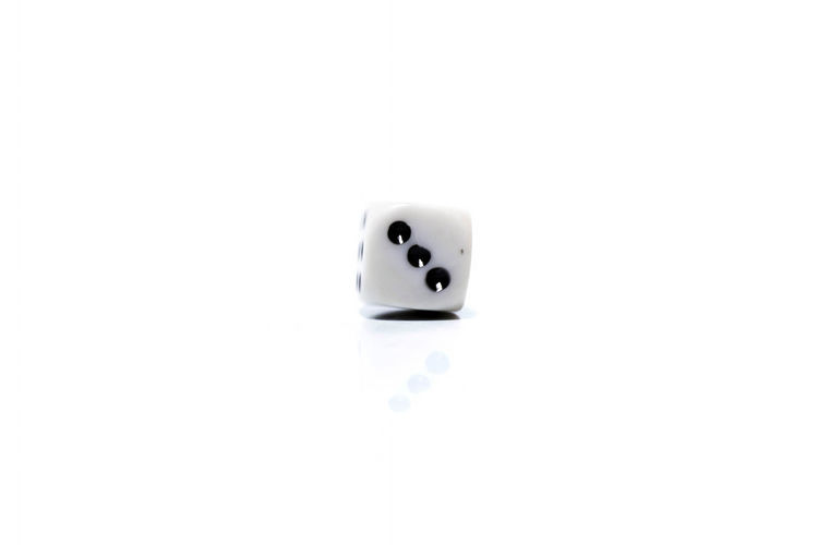 Rolling White dice isolated on white background Arts Culture And Entertainment Black Color Close-up Copy Space Cube Shape Cut Out Dice Emotion Gambling Indoors  Leisure Activity Leisure Games Luck No People Opportunity Relaxation Single Object Studio Shot White Background White Color