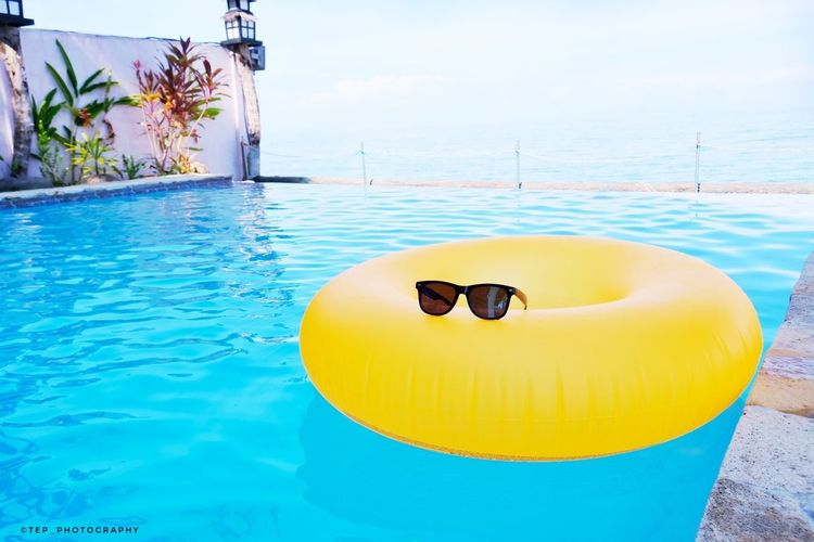 summer is here Neverstopexploring  Lifeinmoments Lifeisanadventure Tropical Wanderlust Vaction Summer Adventure Water Swimming Pool Swimming Sea Flamingo Blue Yellow Summer Sky Inflatable Ring Poolside Floating Pool Party Sun Lounger