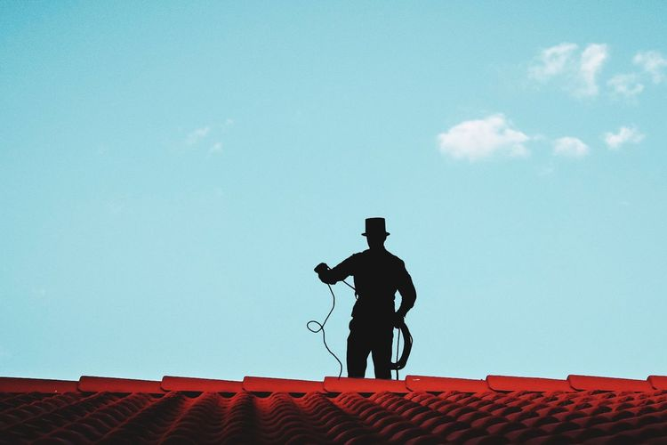 Chimney sweeper on our roof Black Working ChimneySweep Sky Cloud - Sky Nature Full Length Men People Architecture Blue Standing Adult Silhouette Real People Day Outdoors