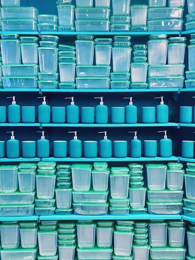 Containers and dispensers on shelf