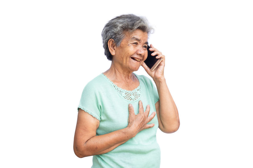 Happy Missing Connection Holding One Person Senior Adult Smart Phone Smiling Standing Talking Technology White Background Women