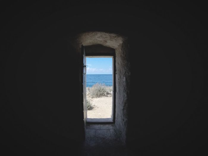 Window Indoors  Day Sea Nature No People Beach Sky Water Horizon Over Water Architecture