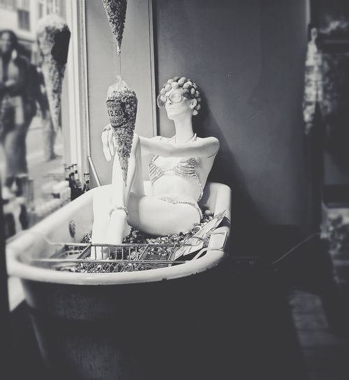 Mannequin In Bathtub At Window Display In Store