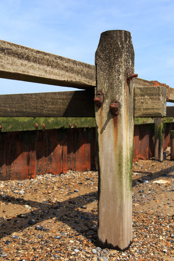 Architecture Beach Blue Built Structure Close-up Day Deterioration Nature No People Old Outdoors Run-down Rural Scene Rust Sky Sunny Wood - Material Wooden Wooden Post