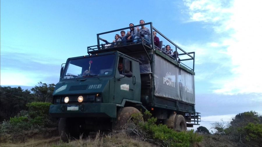 Going to cabo polonio, uruguay Truck Sky Cloud - Sky Nature Transportation Low Angle View Day Mode Of Transportation Plant Land Vehicle Outdoors Field Land Machinery Tree Metal Industry Sunlight