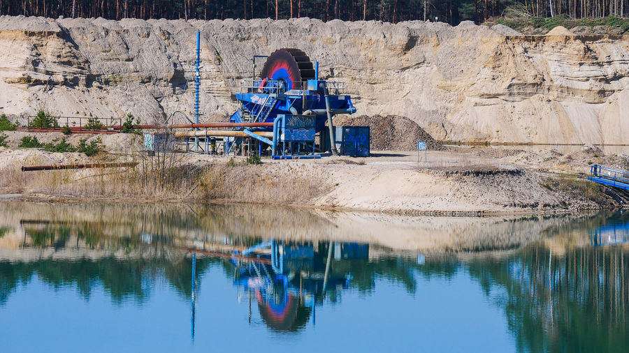 Reflection of goldmining plant in lake