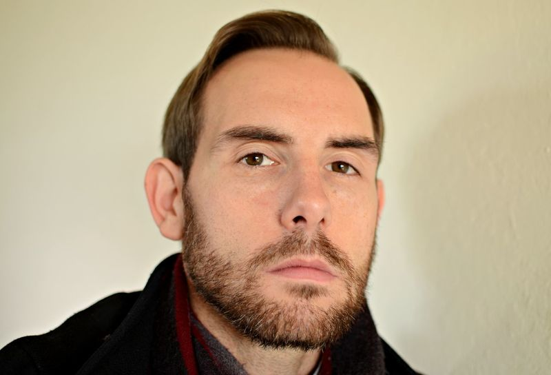 Handsome Man Man Wearing Scarf And Coat Man With Serious Look Beard Bearded Man In Winter Clothes Bedroom Eyes Close-up Headshot Kind Face Looking At Camera Portrait Receding Hairline Studio Shot