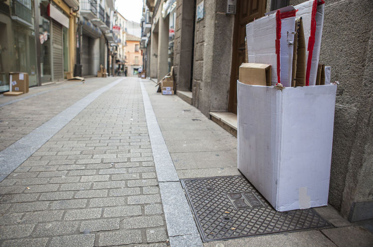 Local businesses place cardboard boxes on the street for recycling Architecture Built Structure Business Finance And Industry City Day No People Outdoors Street