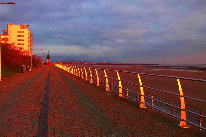 Swansea promenade at sunset Swansea Bay Architecture Building Exterior Built Structure Diminishing Perspective Footpath Horizon Over Water No People Outdoors Promenade Railing Sea Sky Sunset Water