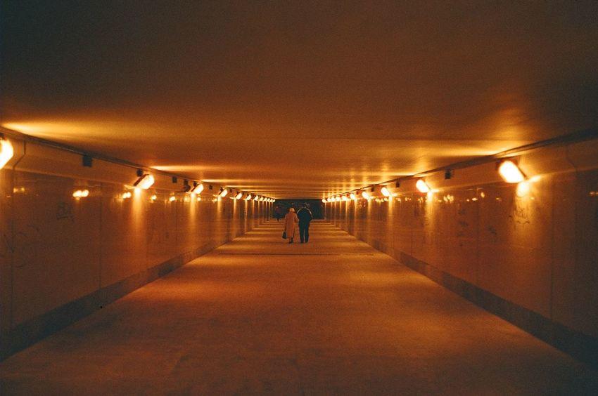 35mm City Life Dark Diminishing Perspective Full Length Illuminated Leisure Activity Lifestyles Light Lighting Equipment Night The Way Forward Tunnel Unrecognizable Person Vanishing Point