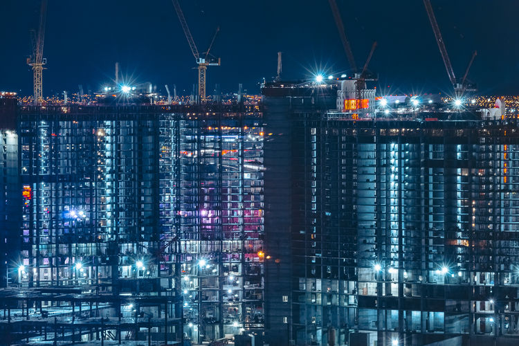 Architecture Building Building Exterior Built Structure City Cityscape Crane - Construction Machinery Financial District  Glowing Illuminated Industry Light Lighting Equipment Machinery Modern Night No People Office Building Exterior Outdoors Reflection Sky Skyscraper Waterfront