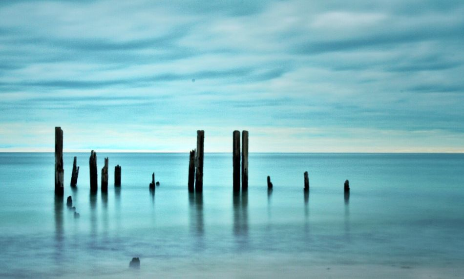 Patience Water Sea Sky Horizon Over Water Tranquility Day Nature No People Wooden Post Cloud - Sky Beauty In Nature Outdoors Scenics
